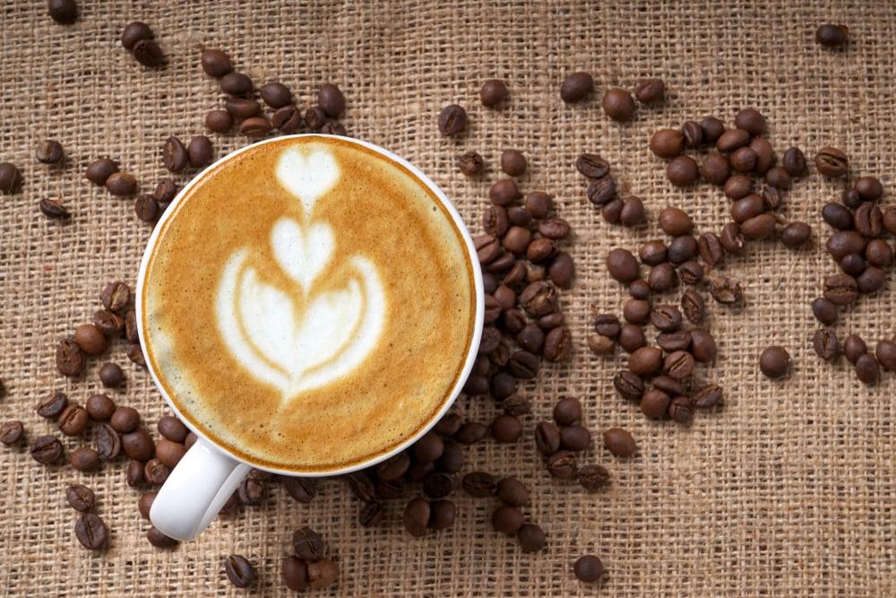 Cup of coffee latte art and coffee beans(PINANDIKA ANINDYA GUNA)s