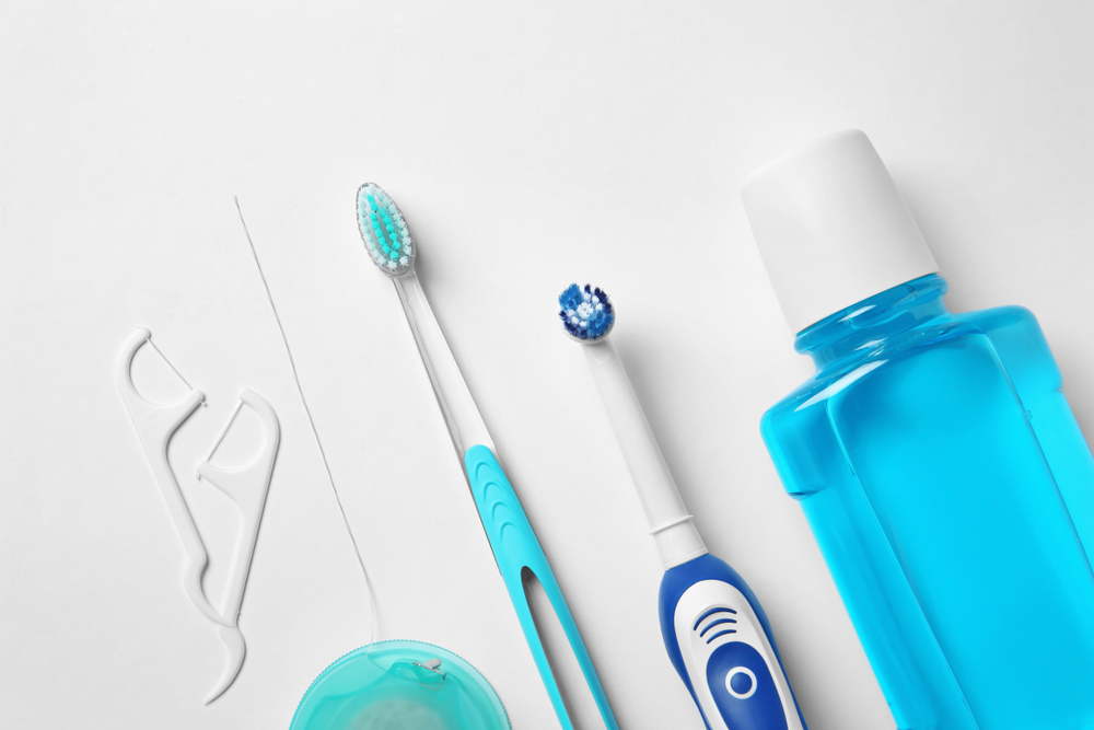 Flat lay composition with toothbrushes and oral hygiene products(New Africa)s