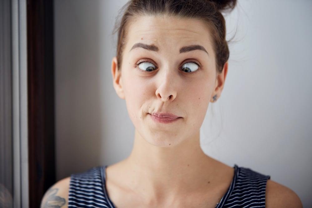 Young brunette woman looking cross-eyed(WAYHOME studio)s