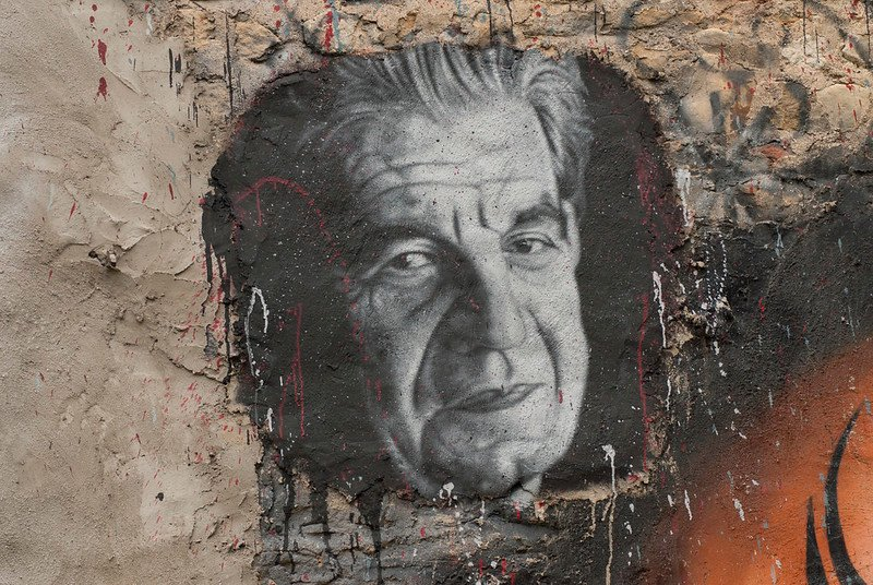 A painted portrait of Jacques Lacan