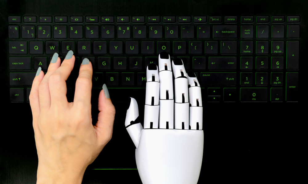 Robot concept chatbot of Human hand and robot hand pressing computer keyboard enter(kung_tom)s