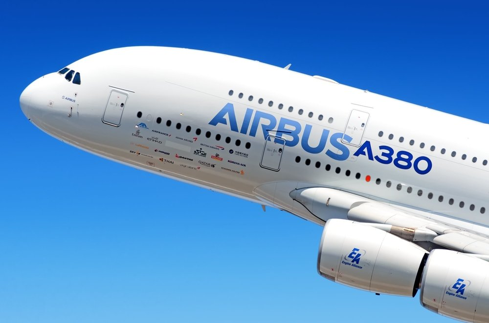 Airbus Industries EADS Airbus A380 super jumbo large wide body passenger airplane flying detail aerial exterior close up crop view(vaalaa)s