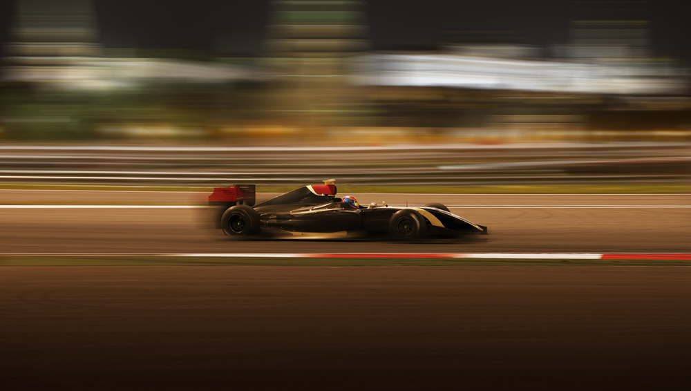 Formula 2.0 race car racing at high speed with motion blur on the background of the city in the dark(Kuznetsov Alexey)s