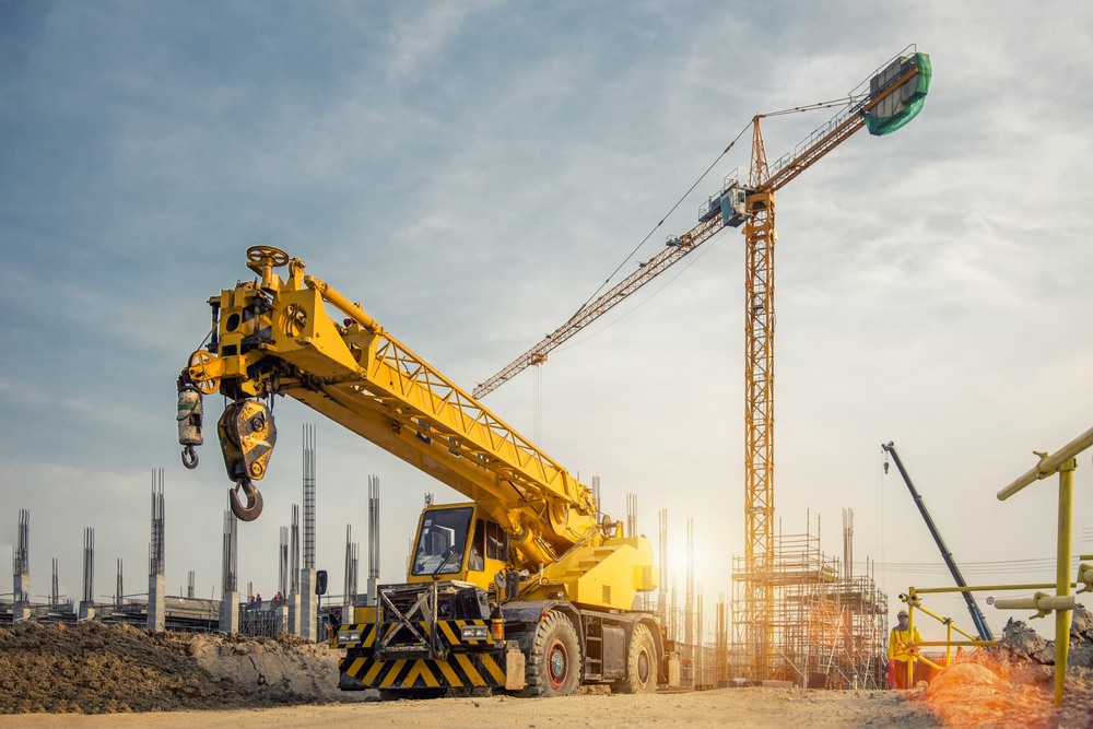 Mobile Crane on a road and tower crane in construction site(Bannafarsai_Stock)s