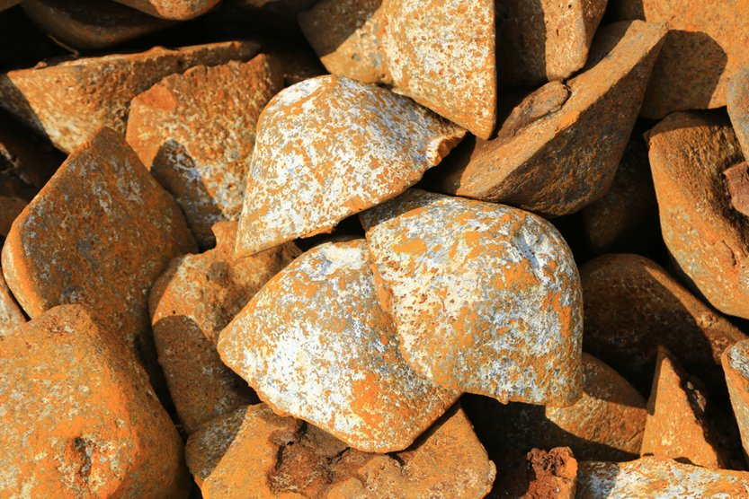 Pig iron is made by smelting iron ore into a transportable ingot of impure high carbon-content iron in a blast furnace as an ingredient for further processing steps( Jamikorn Sooktaramorn)S