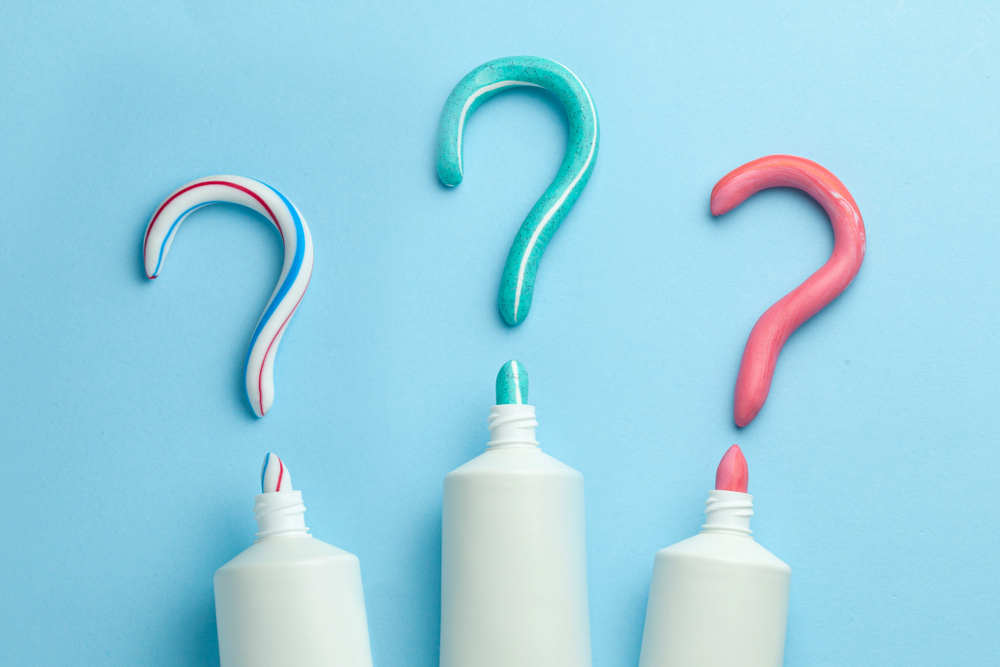 Question mark from toothpaste. Concept of choosing good toothpaste for teeth whitening(ADragan)s