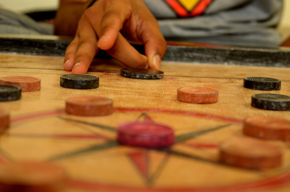 play carrom board game(Mr. Sagar)s