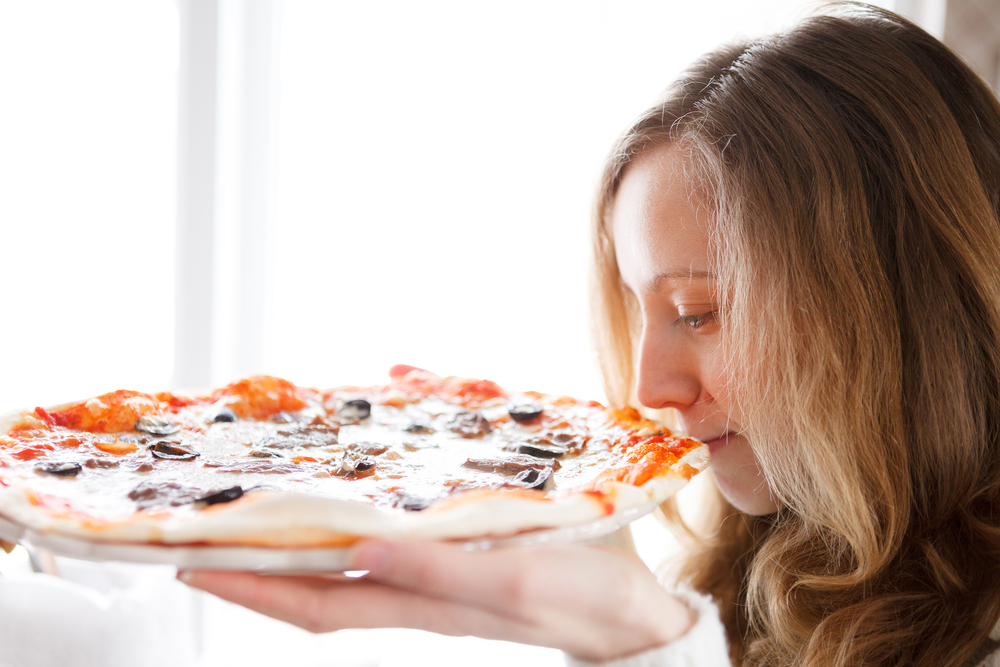 Beautiful girl with pizza(OLEKSANDR SHEVCHENKO)s
