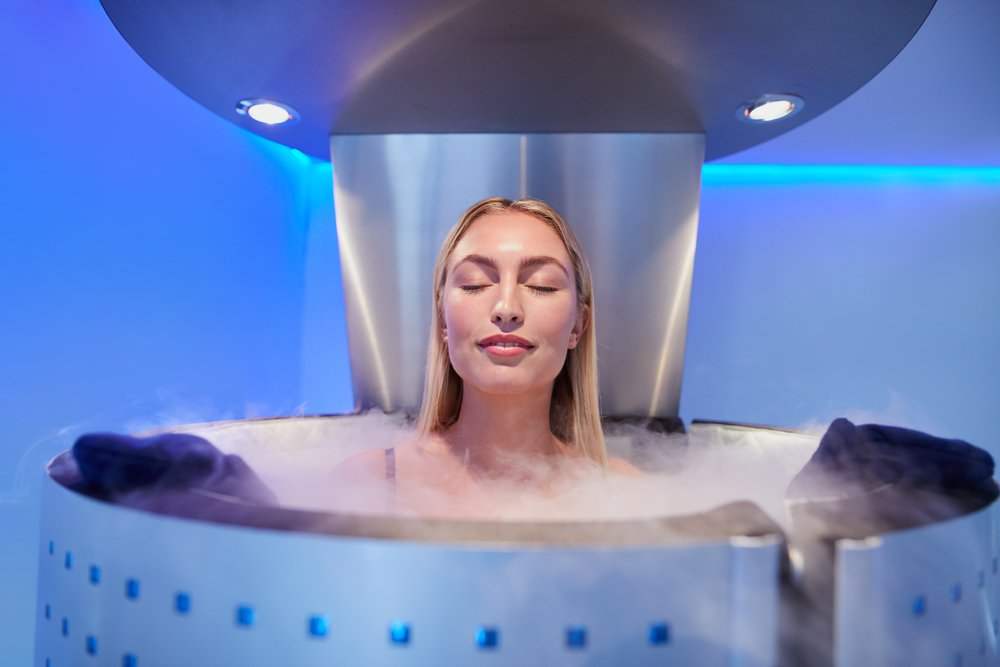 Portrait of happy young woman in a whole body cryotherapy cabin with her eyes closed(Jacob Lund)s