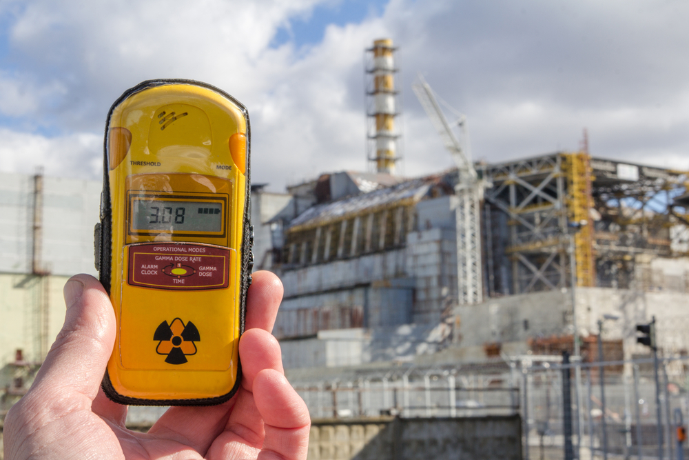 Dosimeter and Nuclear Power Plant on the background(Eight Photo)s