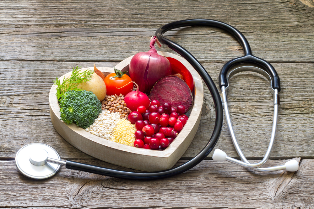Healthy food in heart and cholesterol diet concept on vintage boards(udra11)S