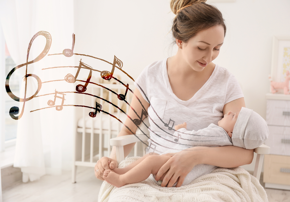 Mother with baby at home. Lullaby songs and music concept(Africa Studio)s