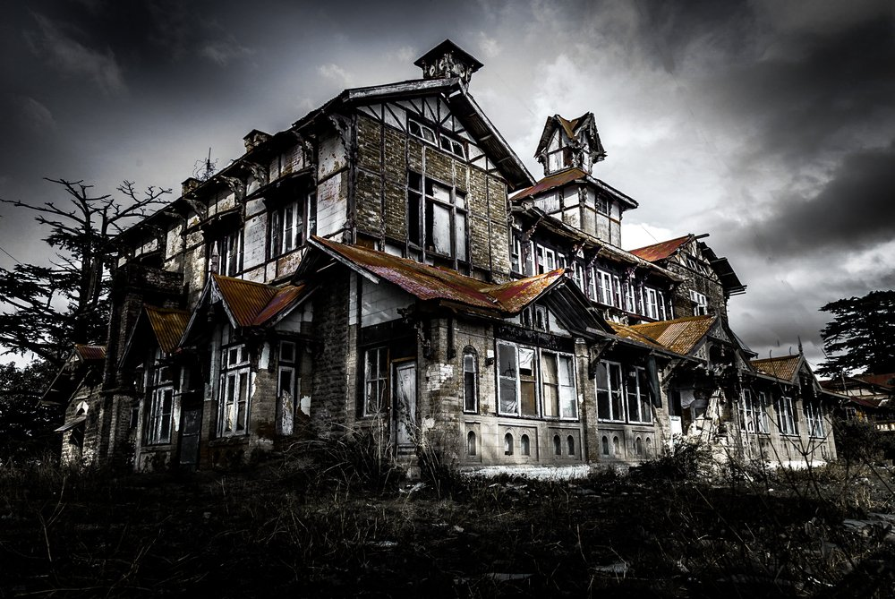 A very big and scary looking abandoned haunted building, house or castle in night(Ram Kay)s