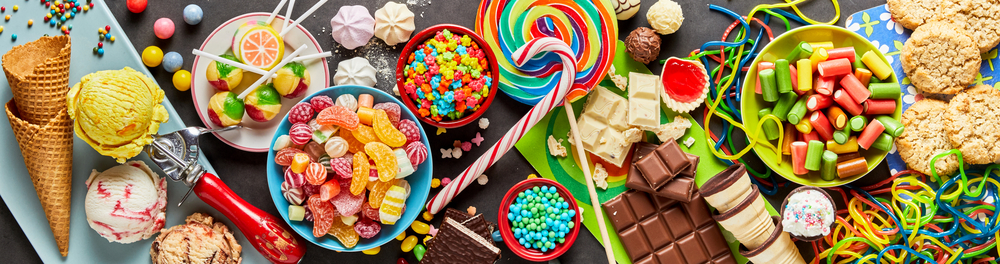 An assortment of colourful, festive sweets, ice-cream and candy in a panoramic orientation(stockcreations)s