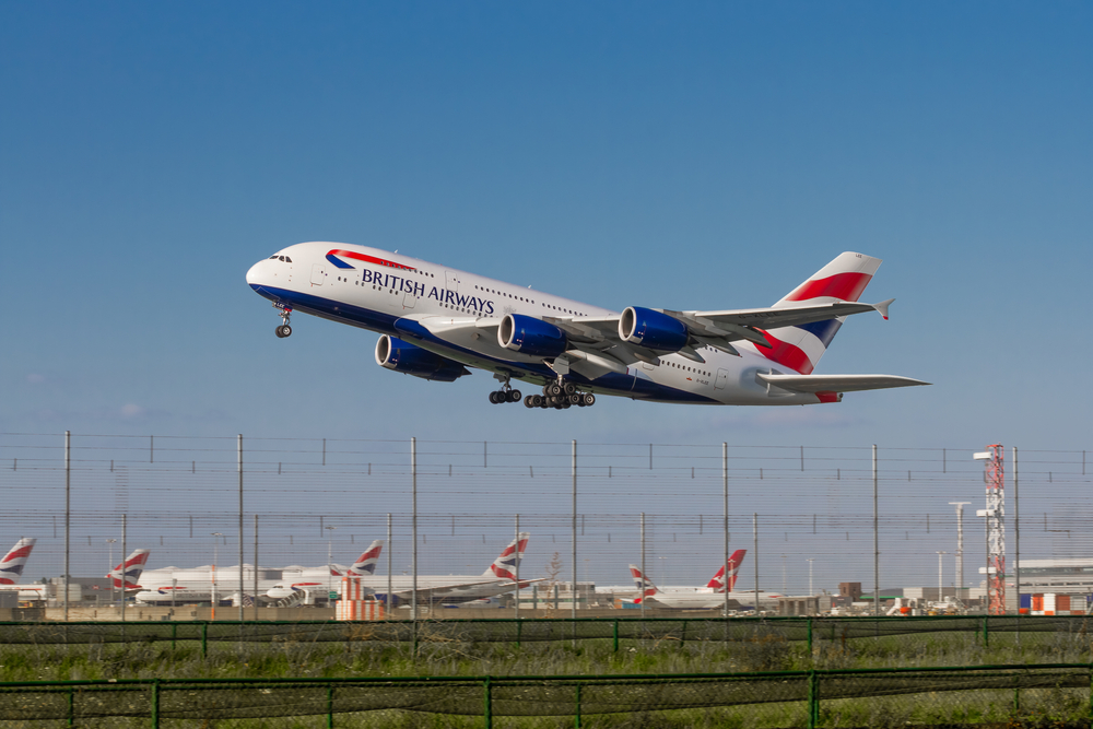 British Airways Airbus A380 taking off from LHR Runway 09R right past parked planes(Abdul N Quraishi - Abs)s