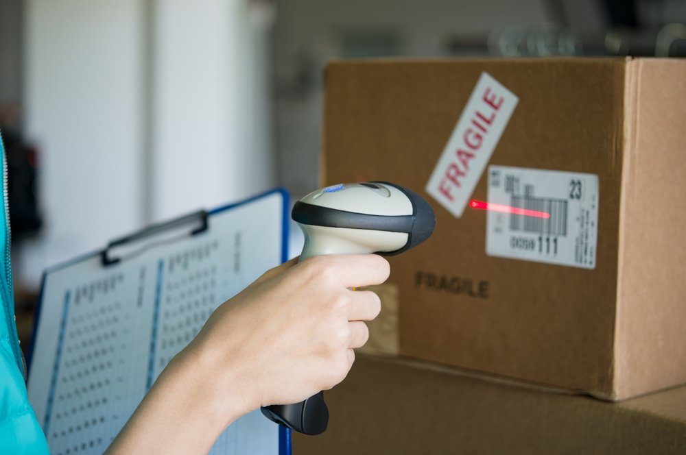 Closeup shot of worker scanning box with barcode reader(Rido)s