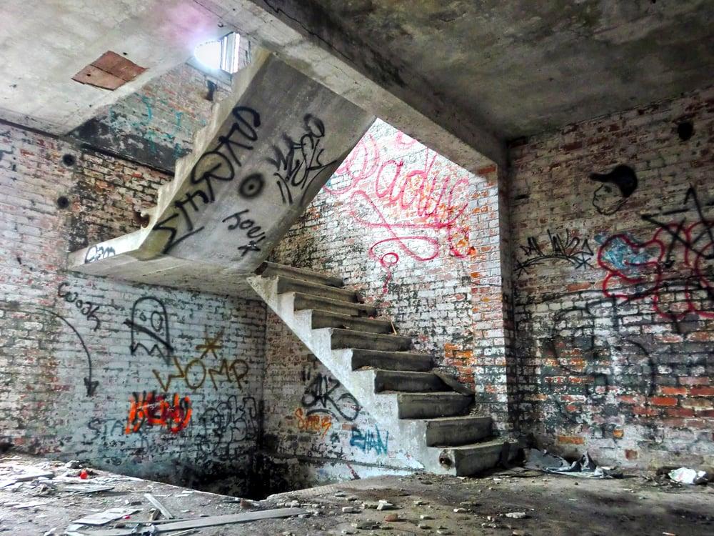 Creepy crumbling staircase inside abandoned building(Josh Cornish)s