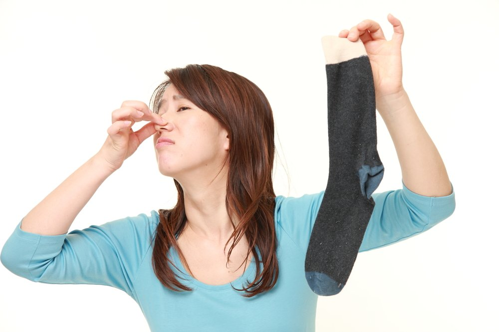 Japanese woman holding her nose because of a bad smell of a socks(UV70)S