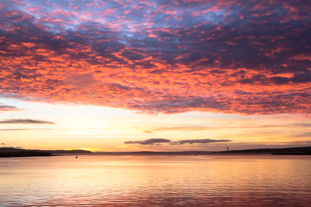 Multicolor clouds above calm North sea in Orkney town during sunrise(Maciej Orlicki)s