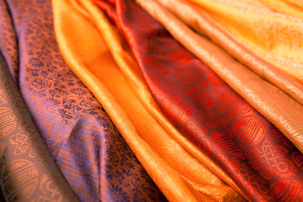 Silk scarves from India in a marketplace(Mara Fribus)s