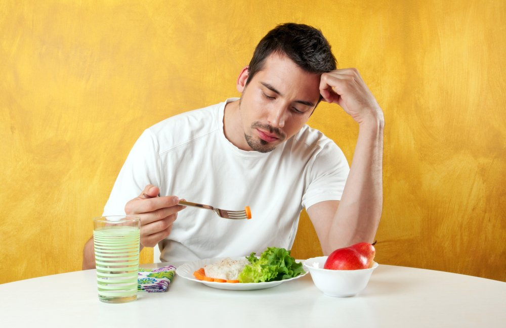 attractive young man not so happy about eating healthy food(Dragana Djorovic)S