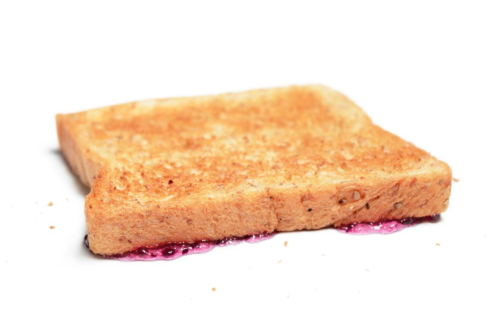 Bread,Falls,Buttered,Side,Down,,Isolated,On,White
