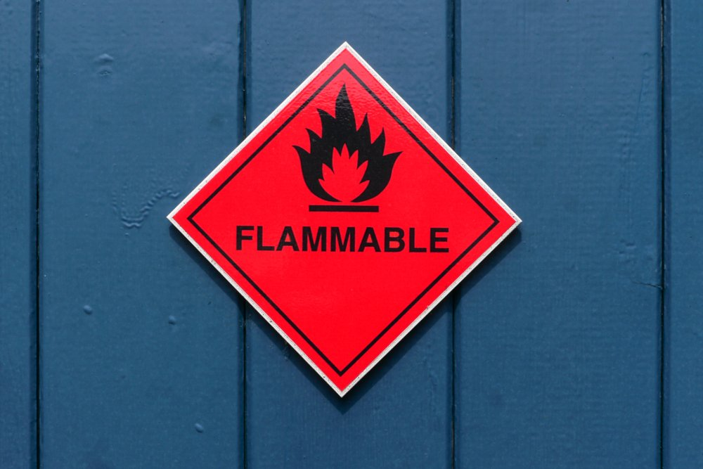Red diamond shape flammable warning sign on red door(larry mcguirk)S