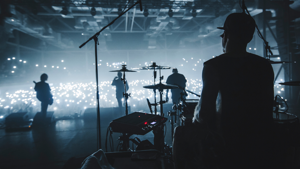 Music band group silhouette perform on a concert stage(Taya Ovod)s