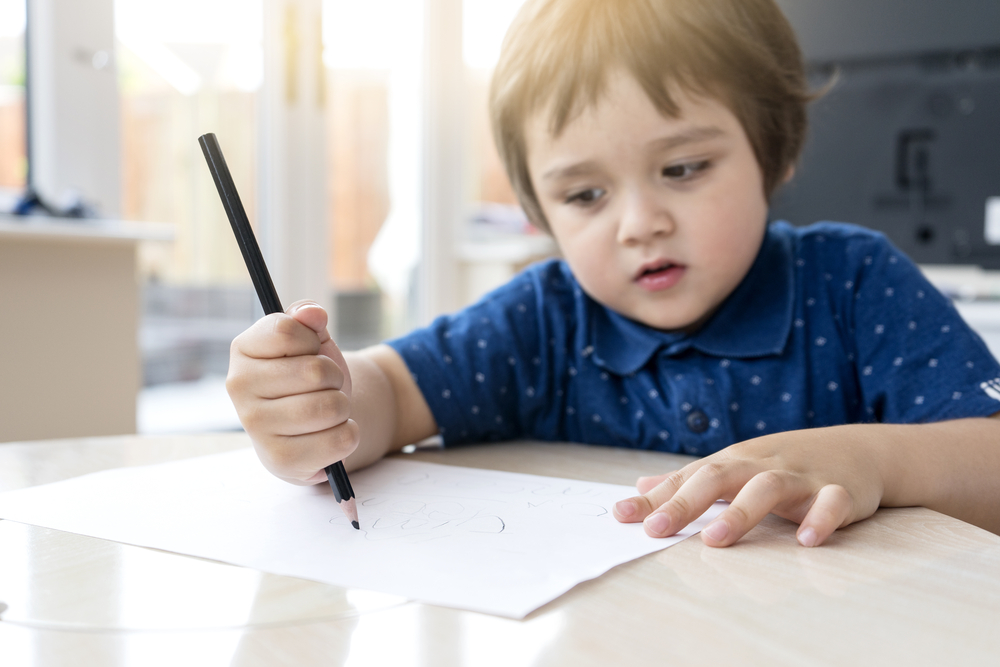 Selective,Focus,Of,Little,Boy,Hands,Learning,How,To,Write
