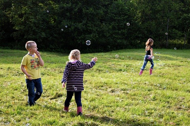 children playing with soap bubble