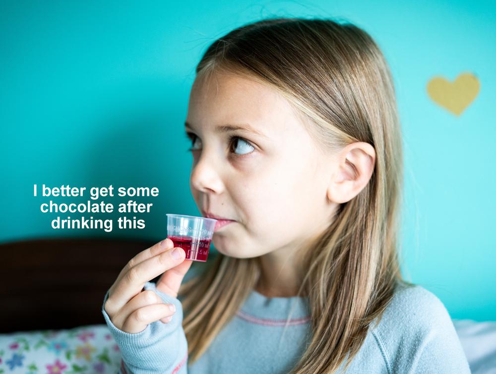 sick-child-taking-medicine-for-fever-or-illnesses-U3UM9MM