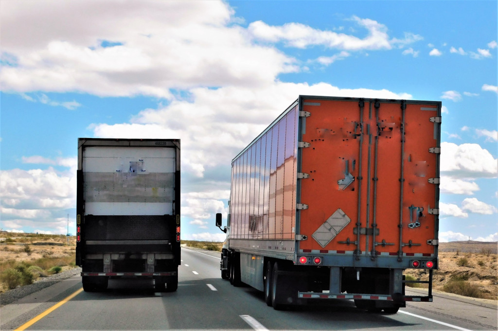 transportation-and-logistics-a-big-rig-truck-is-in-the-fast-lane-of-a-two-lane-highway-in-order-to_t20_8lYLpg