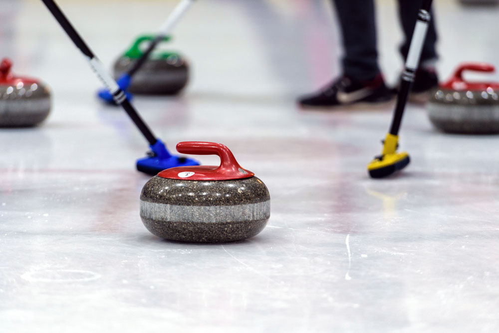 close-up-of-a-curling-game-situation-8SQNG8D