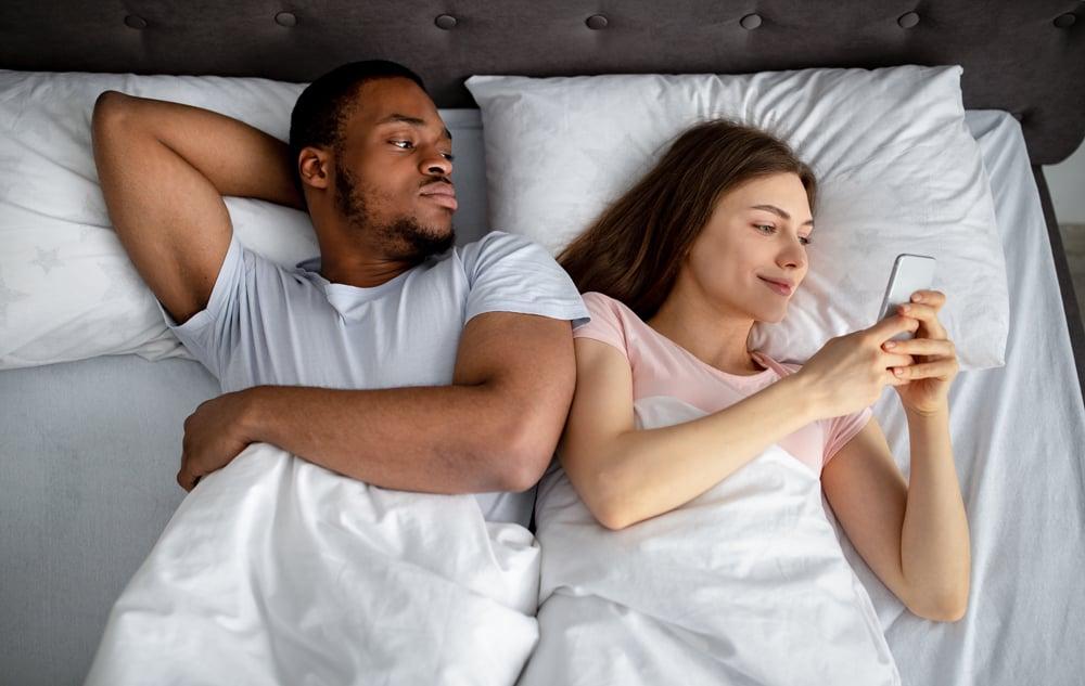 irritated-black-guy-feeling-jealous-of-his-girlfri-DNSBRA3