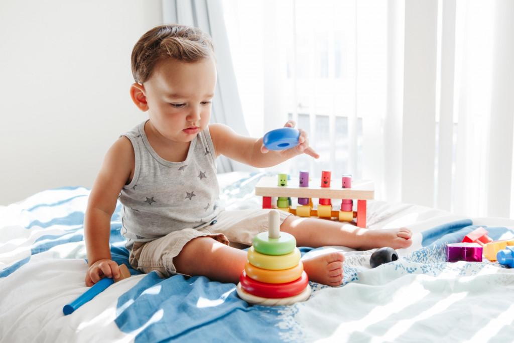 baby-child-playing-sensor-kinetic-toy-stacking-blocks-hand-brain-development-fine-motor-skills_t20_xXo9Z2