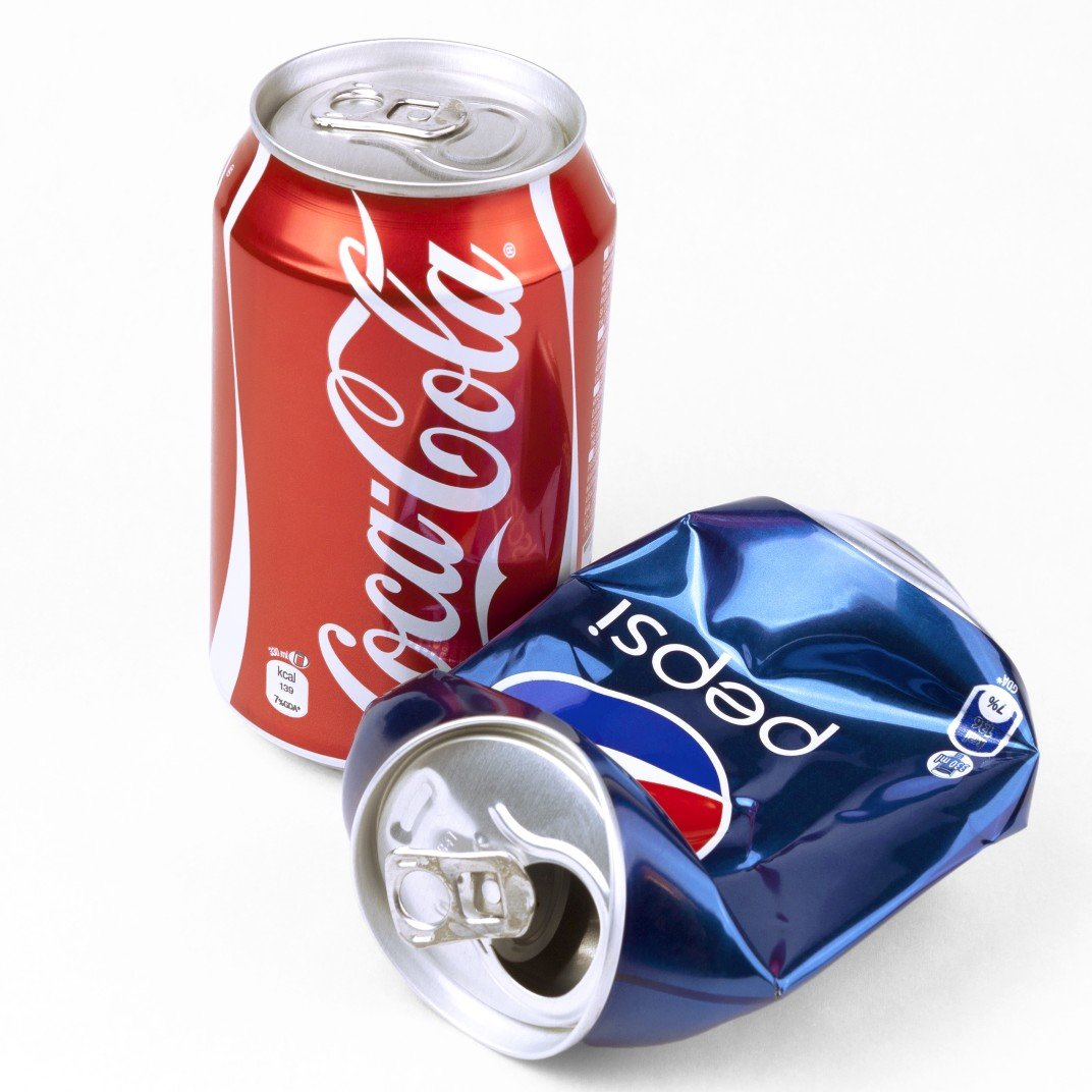 concept-of-competition-as-pepsi-can-is-lying-empty-and-crashed-while-coca-cola-is-still-full-and_t20_lRoZA8