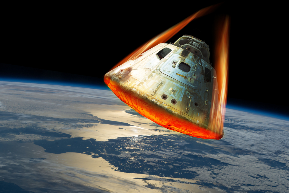 A,Space,Capsule,Reenters,The,Earths,Atmosphere,Causing,The,Heat
